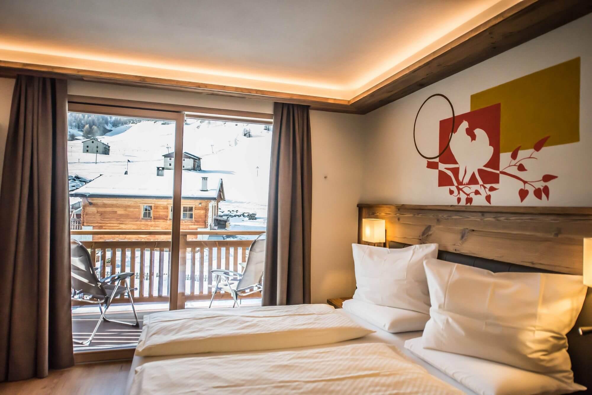 Camera con vista sulle baite di Livigno: Hotel Le Alpi