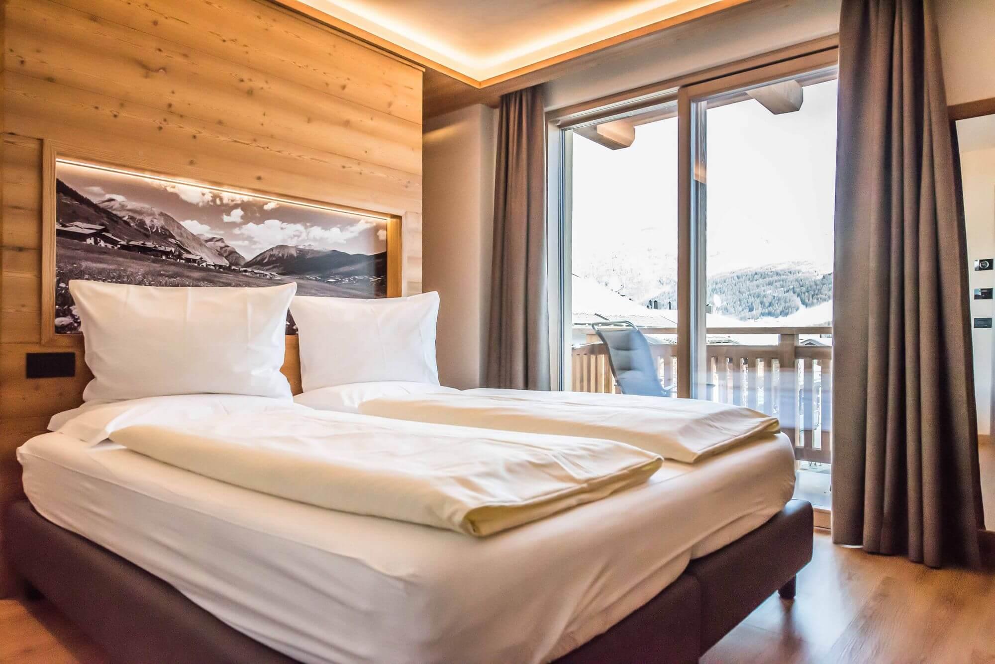 Camera Comfort: terrazzo con vista sulle montagne intorno a Livigno