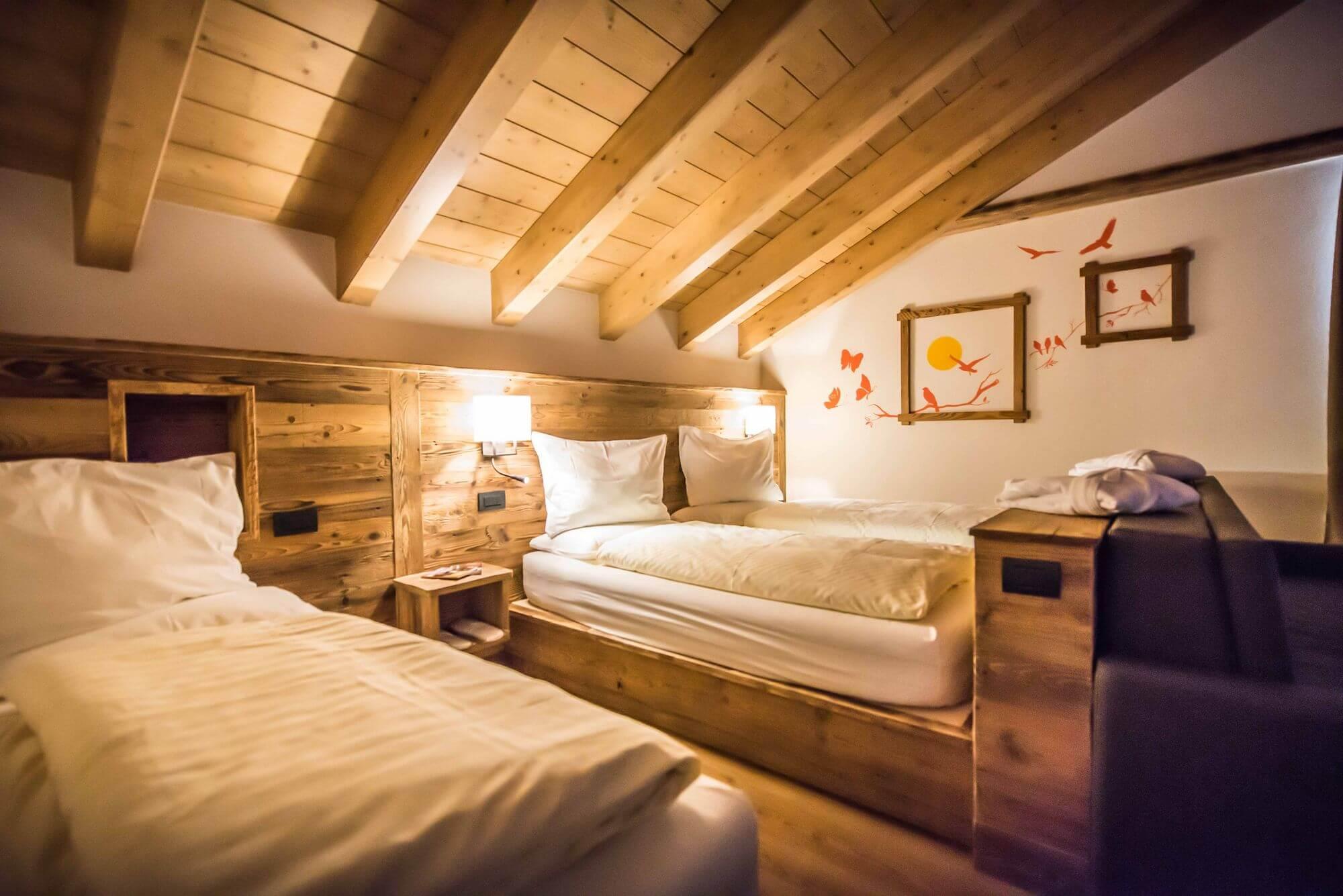 Arredamento in legno: Suite a Livigno